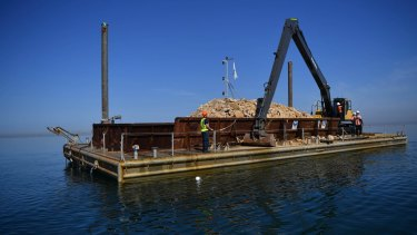 A 20-metre barge loaded with limestone rubble to be planted on the sea bed as part of Victoria's largest reef restoration project in Hobsons Bay and Corio Bay.