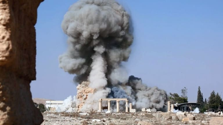 Smoke from the detonation of a 2000-year-old temple in Palmyra.The image was released on an IS social media account.