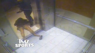 A still of Janay Palmer lying unconscious after being struck in a casino elevator by  Ray Rice.