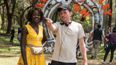 Lupita Nyong'o and director Abe Forsythe on the set of the film Little Monsters in Sydney.