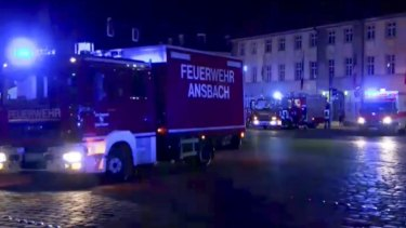 Fire trucks and ambulances stand in the city center of Ansbach.
