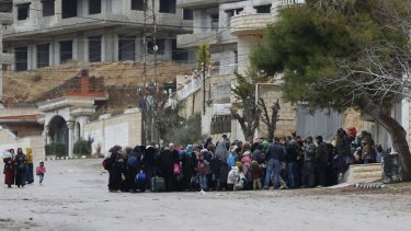 Syrians wait for an aid convoy in the besieged town of Madaya, near Damascus, Syria, last month.