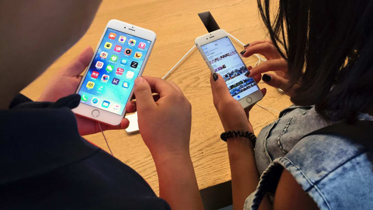 Staff at a Brisbane Apple Store reportedly lifted photos from some customers' iPhones and took more than 100 photos of female customers and staff.