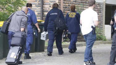 Police search a house in Wentworthville.