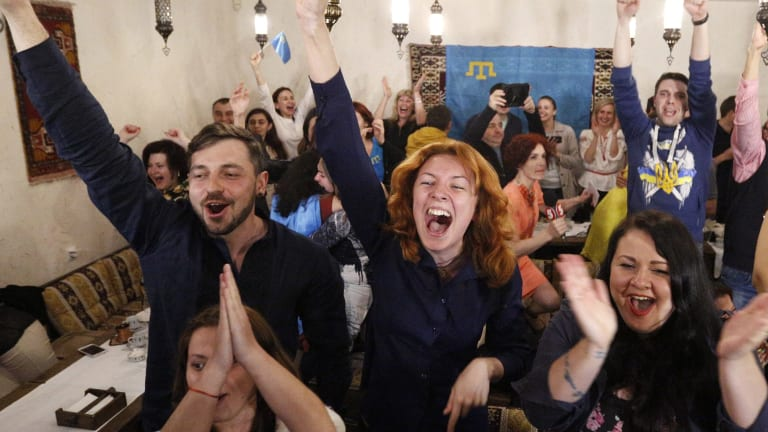 Ukrainians cheer as Jamala wins the 2016 final of the Eurovision Song Contest.