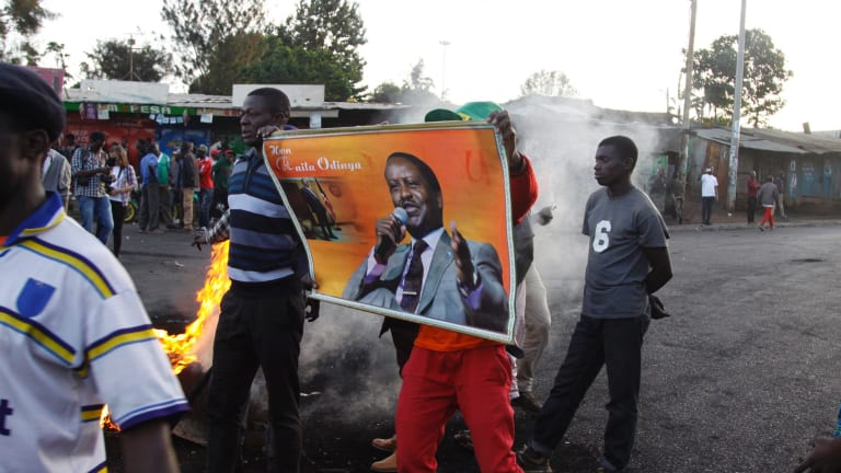 Supporters of opposition leader Raila Odinga protest the results on Monday.