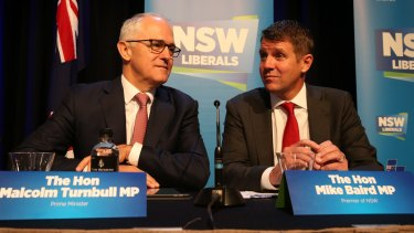 United front: Mr Turnbull and Mr Baird speak at Saturday's NSW Liberal Party state conference.