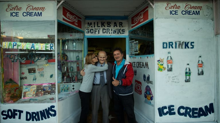 "George Poulos with his daughter, Aphrodite, and son, Nik, outside his milk bar in 2014. ""It gave him something to do — to get up in the morning and do things."""