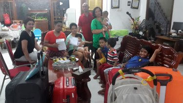 Lucky escape: Christianawati, her husband Ari Putro Cahyono and their extended family after missing flight QZ8501.