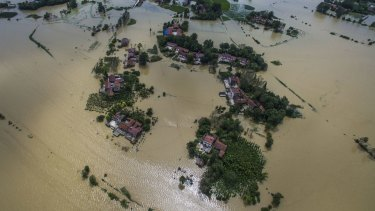 Villages submerged by flood waters in Gaoyang Town, in Hubei Province.