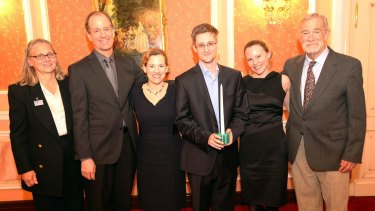 Edward Snowden receives the Sam Adams Associates for Integrity in Intelligence Award alongside British WikiLeaks journalist Sarah Harrison (second right), who took Snowden from Hong Kong to Moscow and obtained his asylum in 2013.