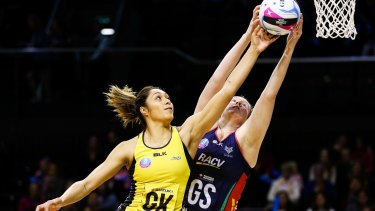Phoenix Karaka, of Central Pulse, and Emma Ryde, of the Melbourne Vixens, compete for the ball during an ANZ Championship match.