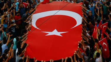 People gather at a pro-government rally in central Istanbul's Taksim square on Saturday.