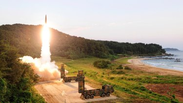 A Hyunmoo II ballistic missile is fired during an exercise at an undisclosed location in South Korea part of a live-fire exercise simulating an attack on North Korea's nuclear test site.