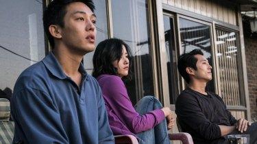 From left, Yoo Ah-in, JunJong-seo and Steven Yeun in Burning.
