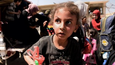 A girl in state of shock arrives with her family at a screening point in western Mosul after being rescued by Iraqi forces.