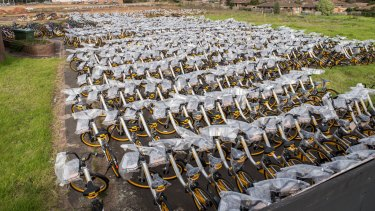 Thousands of oBikes sit in an empty lot in Nunawading.