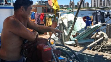 Huang, 47, lives with his family in their fishing boat, near where a new South China Sea museum is being built in Tanmen.