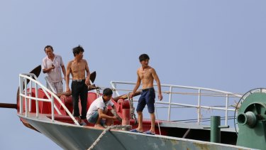 """Fishermen in Tanmen, where some are trained to act as militia upholding Beijing's """"sovereignty"""" in the South China Sea."""
