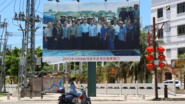 A poster of Chinese President Xi Jinping with local fishermen at the entrance of the port of Tanmen.