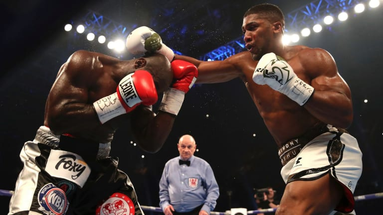 Big blows: Anthony Joshua was taken to the 10th before a TKO decision over Carlos Takam.