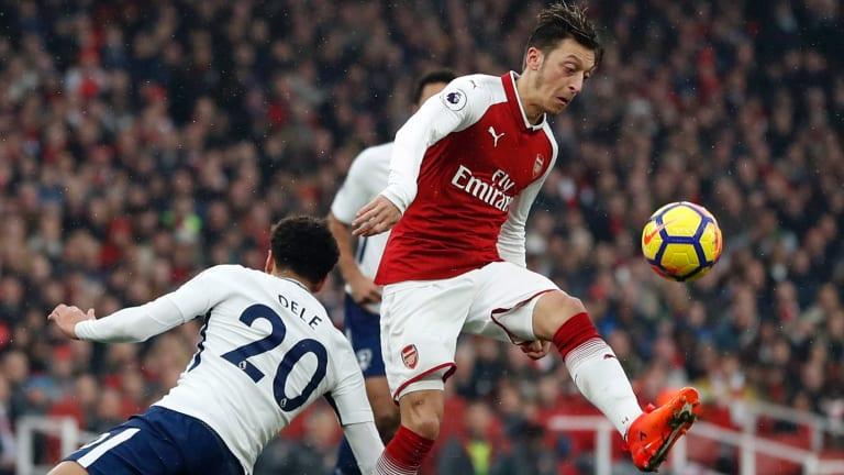 Control: Mesut Ozil is challenged by Tottenham's Dele Alli.