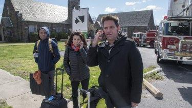 Amtrak train passengers make phone calls after surviving the crash.