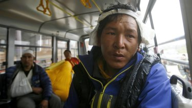Injured Sherpa guides being evacuated from Mount Everest Base Camp on Sunday.