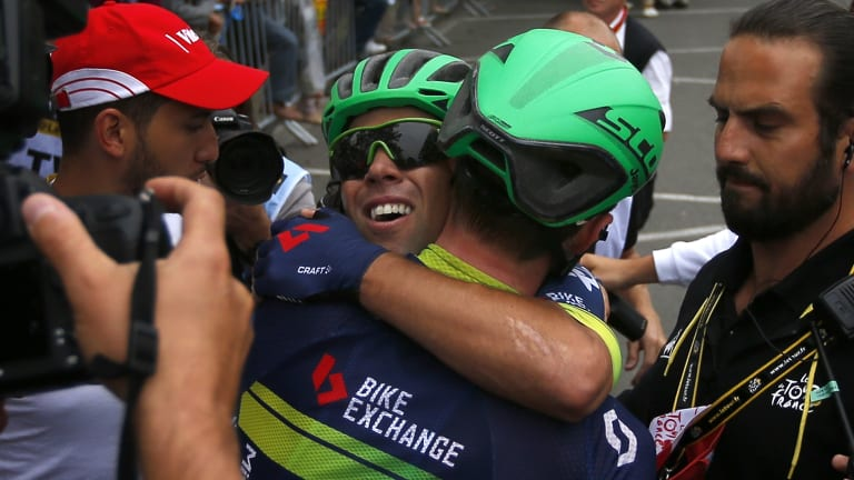 Michael Matthews celebrates with a teammate after the tense finish.