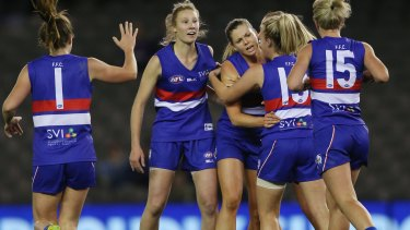 The success of the Western Bulldogs' clash with Melbourne last year has helped provide the impetus for a new AFL women's league - but could they ever line up in a mixed team?