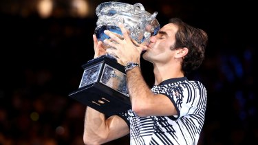 Roger Federer with the Australian Open trophy. Again.