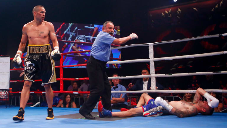 The end: Mundine finishes the fight.
