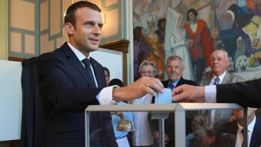 French President Emmanuel Macron casts his ballot in Le Touquet on Sunday.