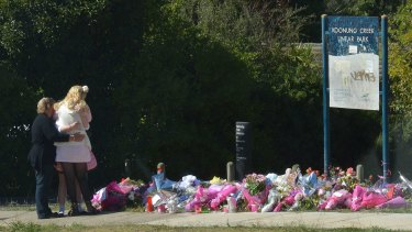 The site of Masa Vukotic's murder in Doncaster covered in pink flowers on Friday.
