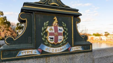 Melbourne's first coat of arms remains visible in the ornate lamp bases along Princes Bridge.