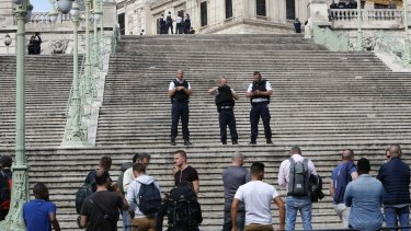 French police officers block access on the stairs leading to Marseille's main train station.