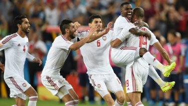Shock of the night: UAE players celebrate their win over Japan.