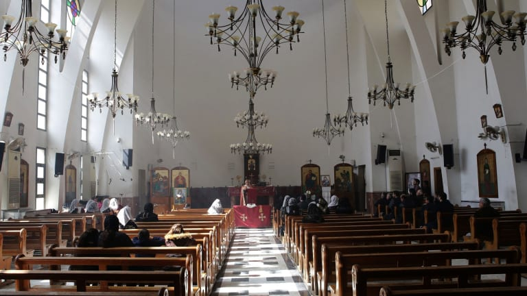 Displaced Assyrians in a prayer at the Greek Catholic church on the outskirts of the capital Damascus.