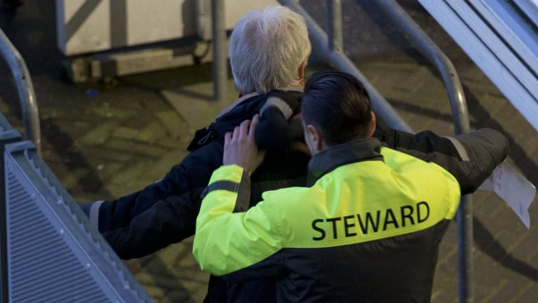 A steward frisks a soccer fan as he enters the stadium ahead of the international friendly soccer match between The Netherlands and France in Amsterdam on Friday. Security has been stepped up across Europe after the Brussels attacks.