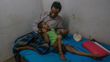Rohingya girl Noor Fatima plays with her father Muheeb-Ullaha as she recovers at Sadar Hospital in Cox's Bazar, Bangladesh. Noor was badly injured when Myanmar soldiers burnt her house.