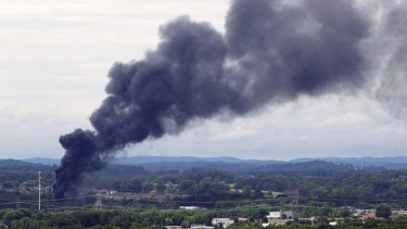 Smoke rises from the site of a train derailment near Maryville, Tennessee.