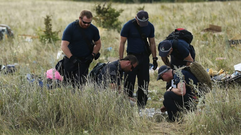 Australian Federal Police officers and their Dutch counterparts at the MH17 crash site in the fields outside the village of Grabovka in eastern Ukraine.