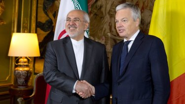 Iranian Foreign Minister Mohammad Javad Zarif, left, shakes hands with his Belgian counterpart Didier Reynders during a meeting at the Egmont Palace in Brussels earlier this month.