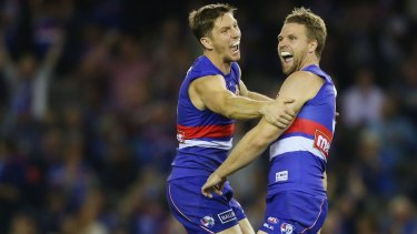 No worries: Matthew Boyd celebrates a goal with Jake Stringer.