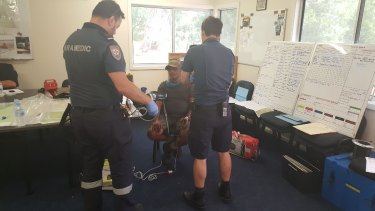 Paramedics checked Mr Ascui over after his rescue.
