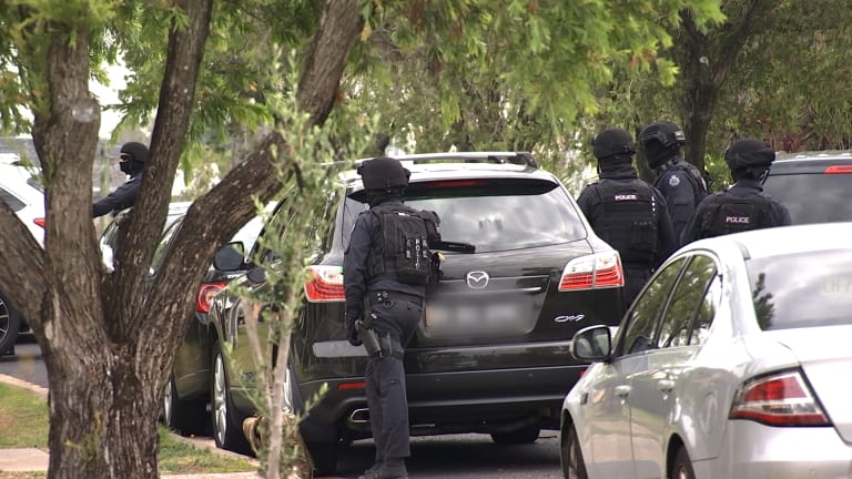 Officers from the Joint Counter Terrorism Team arrest a man at Mount Lewis.