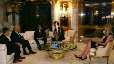 Japanese Prime Minister Shinzo Abe, third from left, meets with Donald Trump, second from left, at Trump Tower on Friday, in the presence of Mr Trump's daughter Ivanka.