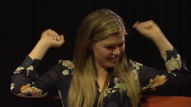 Belle Gibson as she appears in the video.