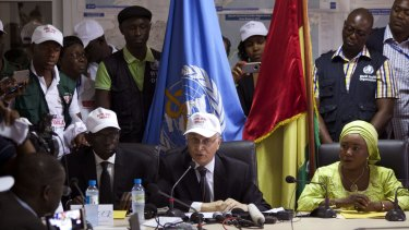 Mohamed Belhocine, centre,  a representative of the World Health Organisation, at a press briefing in Conakry, Guinea, on Tuesday.