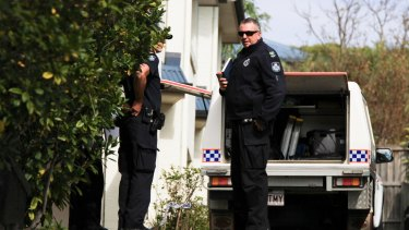 Police at the Bulimba townhouse after the woman was found.